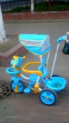 детский велосипед с ручкай